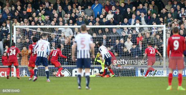 Shaun Cummings of Millwall scores past RonRobert Zieler of Leicester City to make it 10 during The Emirates FA Cup Fifth Round tie between Millwall...