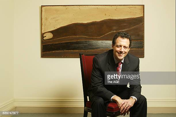 Shaun Dennison at Chrsities 1 Darling Street South Yarra Pictured in front of painting by Rover Thomas Lundari Barramundi Dreaming 1985 Shaun...