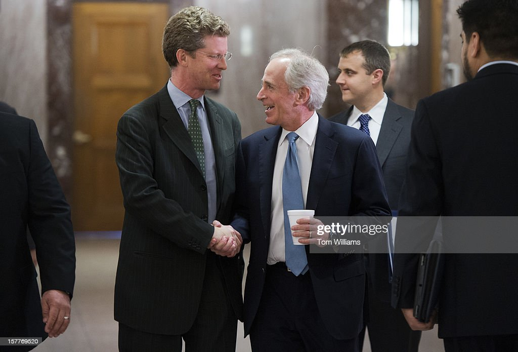 Shaun Donovan, left, HUD Secretary, talks with Sen. Bob Corker, R-Tenn., before a Senate Banking, Housing and Urban Affairs Committee hearing in Dirksen entitled 'Oversight of FHA (Federal Housing Administration): Examining HUD's Response to Fiscal Challenges.'