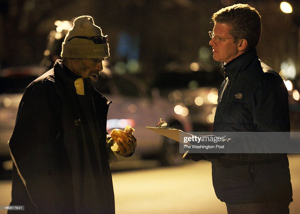 Shaun Donovan, right, H.U.D. Secretary, interviews a homeless citizen on the streets on January, 31, 2013 in Washington, DC.