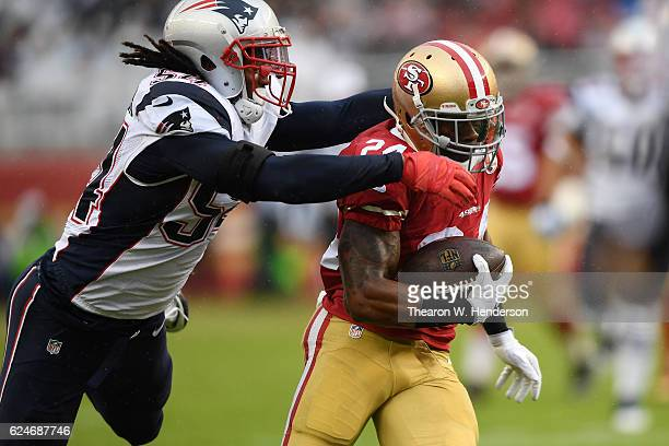 Shaun Draughn of the San Francisco 49ers is tackled by Dont'a Hightower of the New England Patriots during their NFL game at Levi's Stadium on...