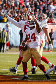 Shaun Draughn of the San Francisco 49ers reacts after scoring against the Chicago Bears in the second quarter at Soldier Field on December 6 2015 in...