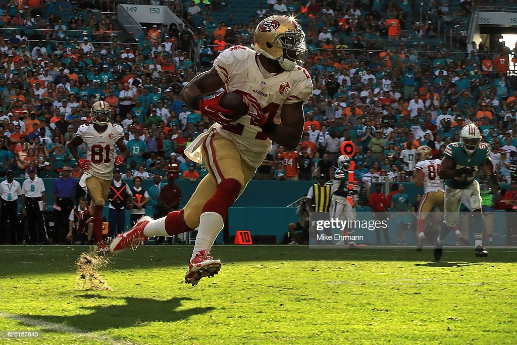 Shaun Draughn #24 of the San Francisco 49ers rushes during a game against the Miami Dolphins on November 27, 2016 in Miami Gardens, Florida.