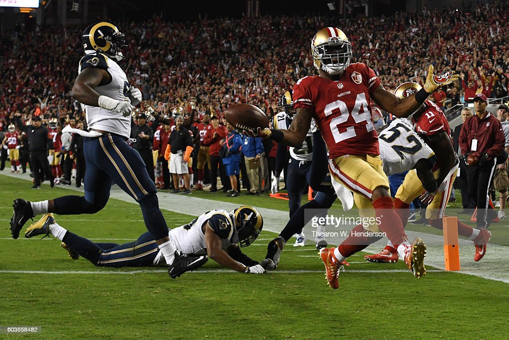 Shaun Draughn #24 of the San Francisco 49ers scores a touchdown on a three yard run against the Los Angeles Rams during their NFL game at Levi's Stadium on September 12, 2016 in Santa Clara, California.