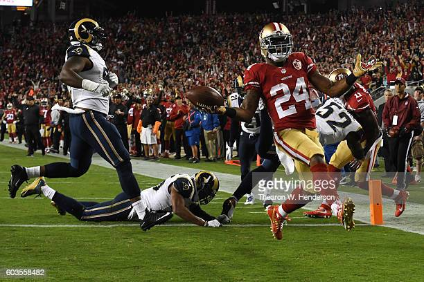 Shaun Draughn of the San Francisco 49ers scores a touchdown on a three yard run against the Los Angeles Rams during their NFL game at Levi's Stadium...