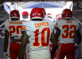 Shaun Draughn Terrance Copper and Cyrus Gray of the Kansas City Chiefs head out to the field to play against the San Diego Chargers on November 1...