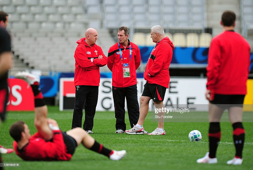 Shaun Edwards (assistant coach), Rob Howley (assistant coach) and Warren Gatland (head coach) chat during a Wales IRB Rugby World Cup 2011 captain's run at Eden Park on October 14, 2011 in Auckland, New Zealand.