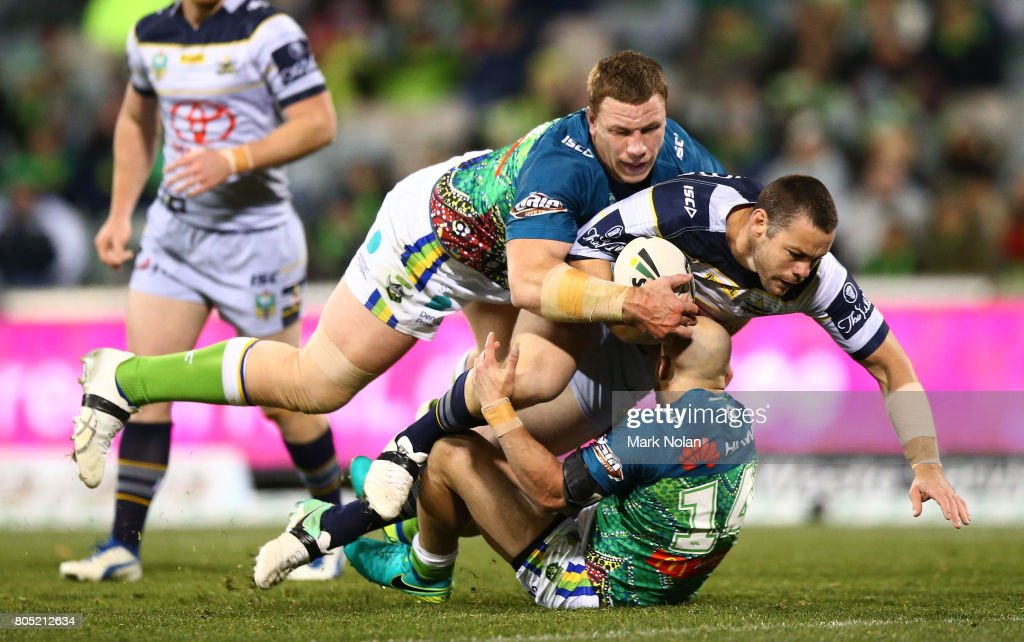 Shaun Fensom of the Cowboys is tackled during the round 17 NRL match between the Canberra Raiders and the North Queensland Cowboys at GIO Stadium on July 1, 2017 in Canberra, Australia.