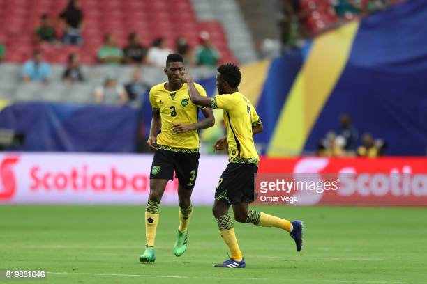 Shaun Francis of Jamaica celebrates with teammate Damion Lowe after scoring the first goal of his team during the CONCACAF Gold Cup Quarterfinal...