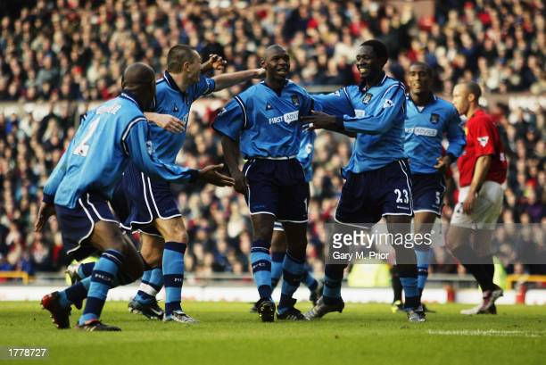 Shaun Goater of Manchester City celebrates scoring the equalising goal with his teammates during the FA Barclaycard Premiership match between...