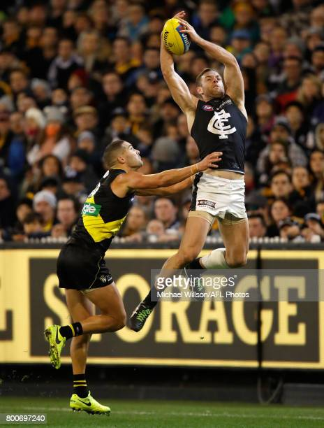 Shaun Grigg of the Tigers and Sam Docherty of the Blues compete for the ball during the 2017 AFL round 14 match between the Richmond Tigers and the...