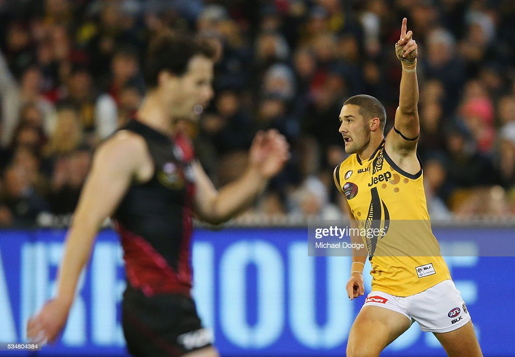 Shaun Grigg of the Tigers celebrates a goal during the round 10 AFL match between the Essendon Bombers and the Richmond Tigers at Melbourne Cricket Ground on May 28, 2016 in Melbourne, Australia.