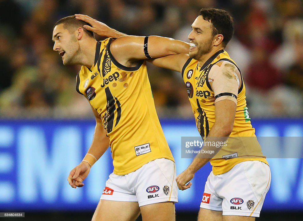 Shaun Grigg of the Tigers celebrates a goal with Shane Edwards (R) during the round 10 AFL match between the Essendon Bombers and the Richmond Tigers at Melbourne Cricket Ground on May 28, 2016 in Melbourne, Australia.