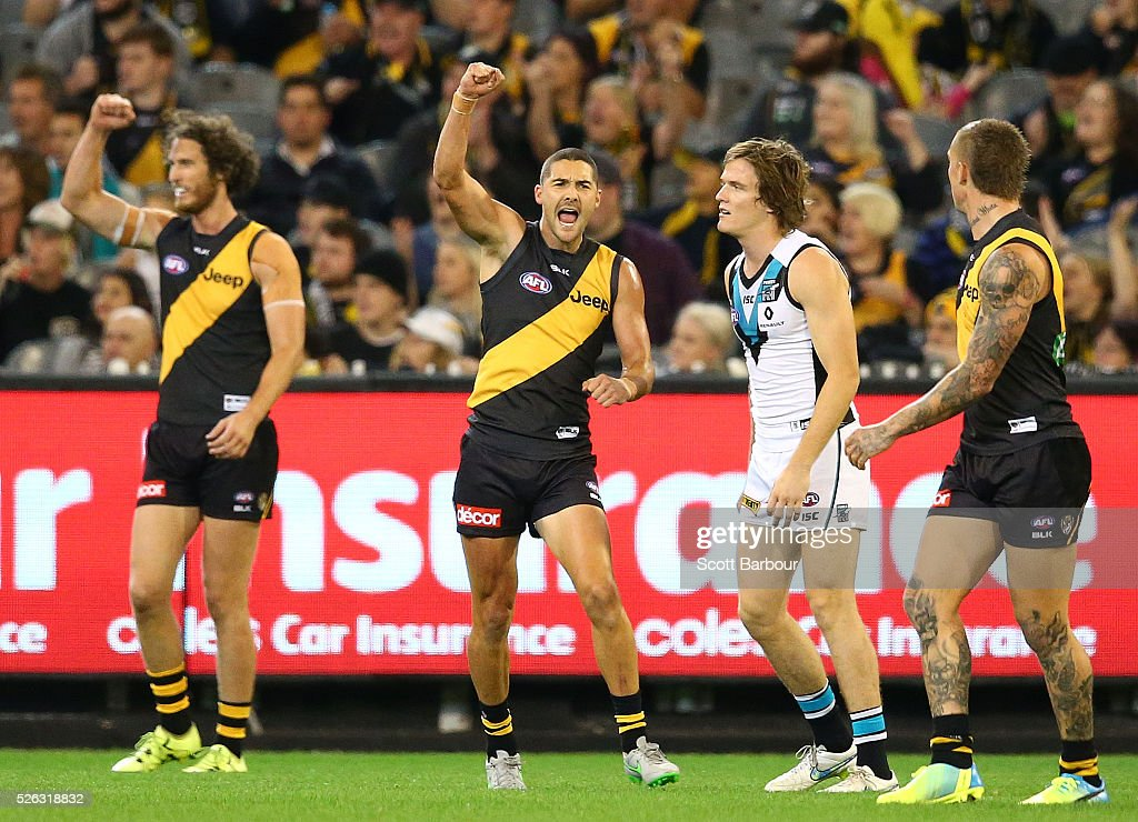 Shaun Grigg of the Tigers celebrates after kicking a goal as Tyrone Vickery of the Tigers looks on during the round six AFL match between the Richmond Tigers and the Port Adelaide Power at Melbourne Cricket Ground on April 30, 2016 in Melbourne, Australia.