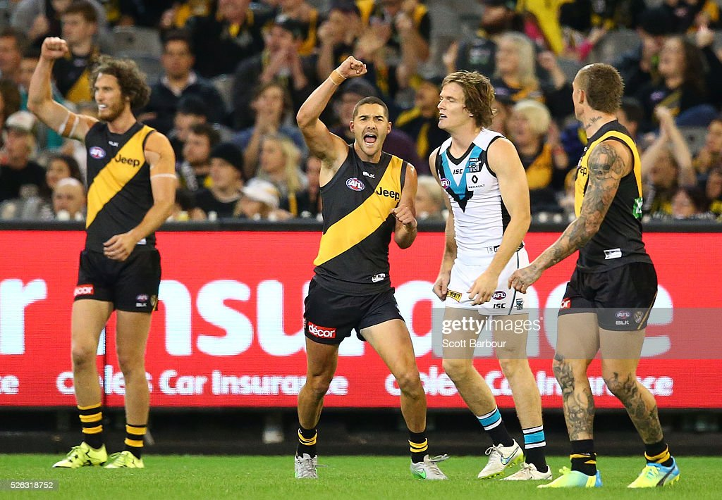 Shaun Grigg of the Tigers celebrates after kicking a goal during the round six AFL match between the Richmond Tigers and the Port Adelaide Power at Melbourne Cricket Ground on April 30, 2016 in Melbourne, Australia.