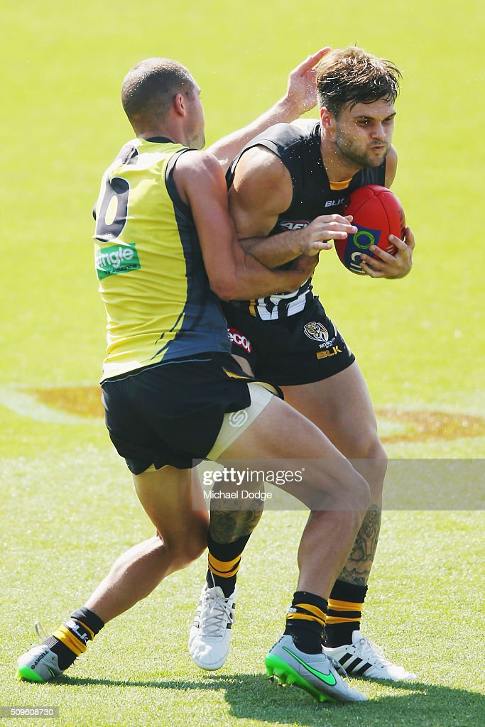 Shaun Grigg of the Tigers tackles Ben Lennon of the Tigers during the Richmond Tigers AFL intra-club match at Punt Road Oval on February 12, 2016 in Melbourne, Australia.