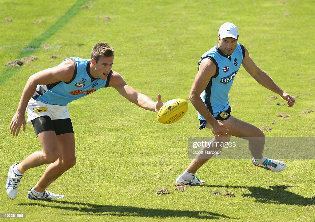 Shaun Hampson (L) and Chris Judd of the Blues compete for the ball during a Carlton Blues AFL training session at Visy Park on March 7, 2013 in Melbourne, Australia.
