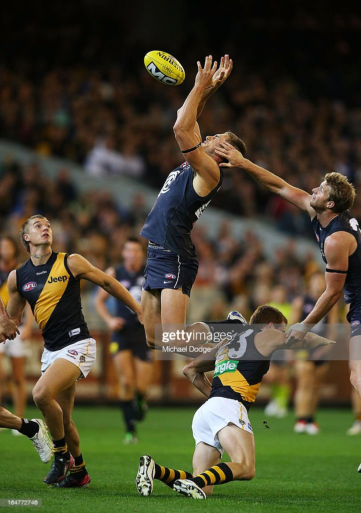 A Shaun Hampson of the Blues contests for the ball against Daniel Jackson of the Tigers during the round one AFL match between the Carlton Blues and the Richmond Tigers at Melbourne Cricket Ground on March 28, 2013 in Melbourne, Australia.