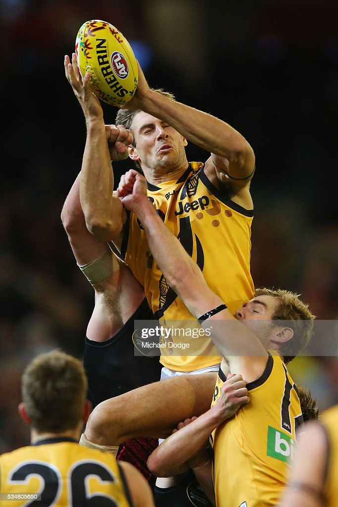 Shaun Hampson of the Tigers competes for the ball during the round 10 AFL match between the Essendon Bombers and the Richmond Tigers at Melbourne Cricket Ground on May 28, 2016 in Melbourne, Australia.