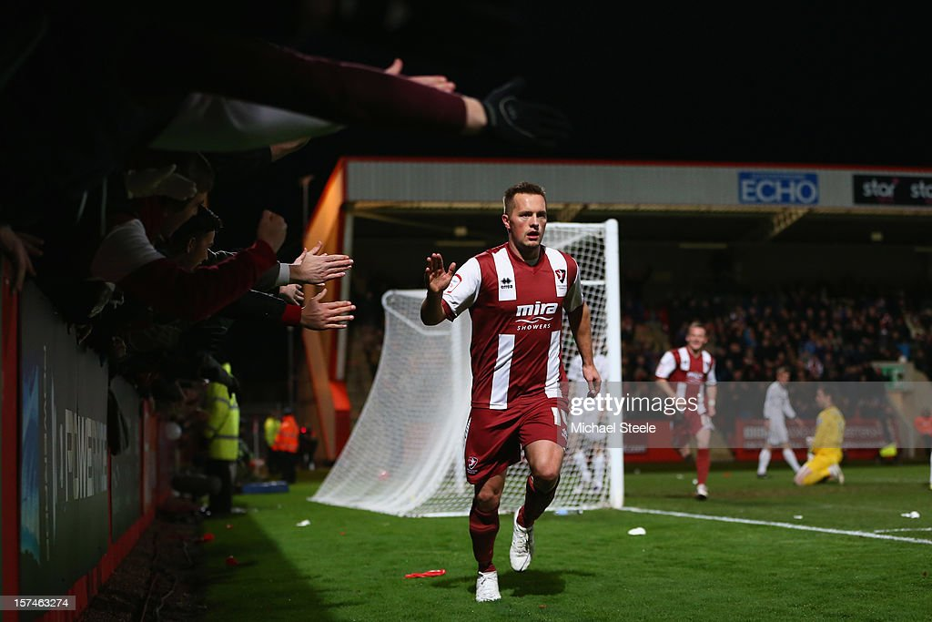 <a gi-track='captionPersonalityLinkClicked' href=/galleries/search?phrase=Shaun+Harrad&family=editorial&specificpeople=2089486 ng-click='$event.stopPropagation()'>Shaun Harrad</a> of Cheltenham Town celebrates scoring the opening goal during the FA Cup with Budweiser Second Round match between Cheltenham Town and Hereford United at the Abbey Business Stadium on December 3, 2012 in Cheltenham, England.