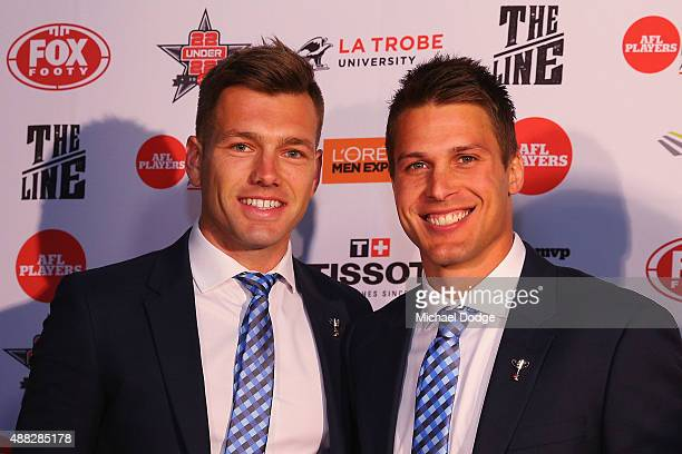 Shaun Higgins and Andrew Swallow of Kangaroos pose during the announcement of the AFLPA MVP at Shed 14 Central Pier on September 15 2015 in Melbourne...