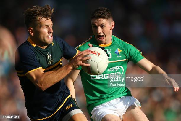 Shaun Higgins of Australia looks to break from Shane Walsh of Ireland during game two of the International Rules Series between Australia and Ireland...