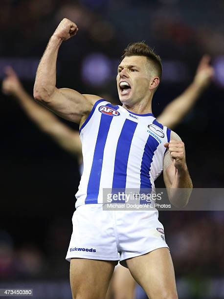 Shaun Higgins of the Kangaroos celebrates a match winning goal during the round seven AFL match between the Essendon Bombers and the North Melbourne...