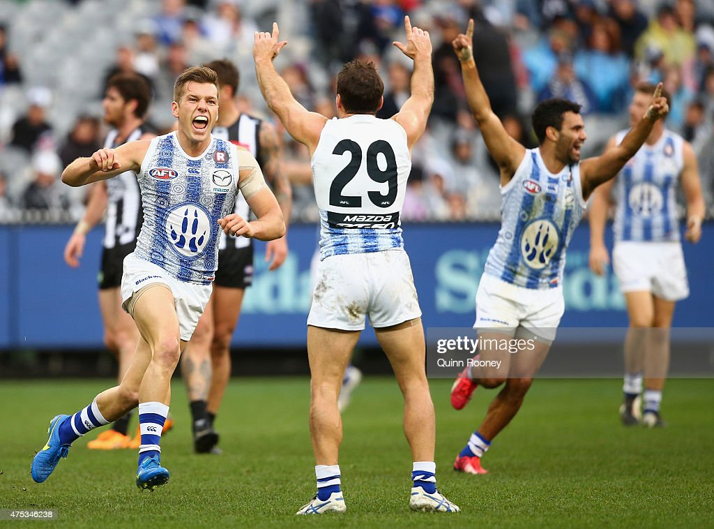 Shaun Higgins of the Kangaroos celebrates kicking a goal during the round nine AFL match between the Collingwood Magpies and the North Melbourne...