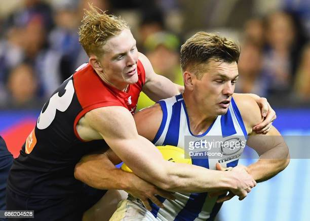 Shaun Higgins of the Kangaroos is tackled by Clayton Oliver of the Demons during the round nine AFL match between the Melbourne Demons and the North...