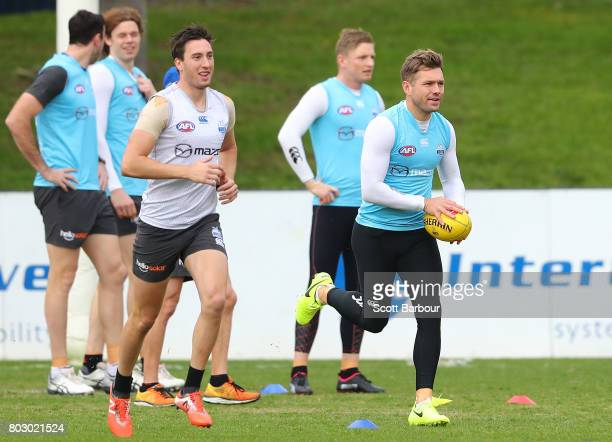 Shaun Higgins of the Kangaroos runs with the ball during a North Melbourne Kangaroos AFL training session at Arden Street Ground on June 29 2017 in...