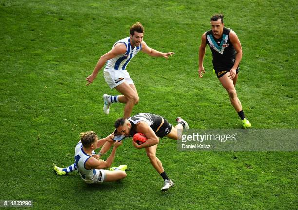 Shaun Higgins of the Kangaroos tackles Jarman Impey of the Power during the round 17 AFL match between the Port Adelaide Power and the North...