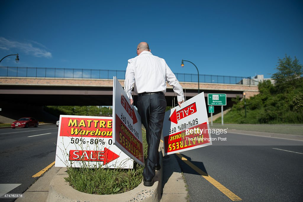 shaun hiltner rockville pike mattress warehouse store manager posts sale signs at the of montrose