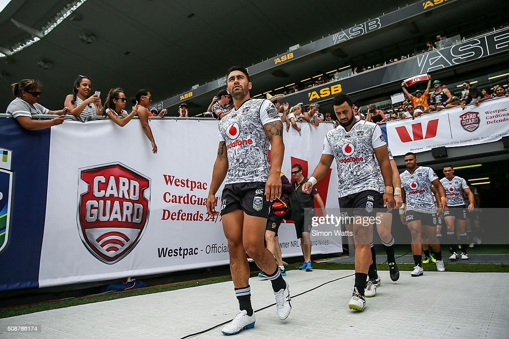 Shaun Johnson (L) and Ben Matulino of the Warriors leads the Warriors onto Eden Park before the 2016 Auckland Nines match between the Warriors and the Broncos at Eden Park on February 7, 2016 in Auckland, New Zealand.