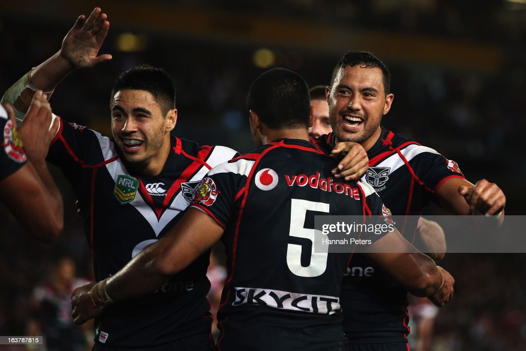 <a gi-track='captionPersonalityLinkClicked' href=/galleries/search?phrase=Shaun+Johnson&family=editorial&specificpeople=6382622 ng-click='$event.stopPropagation()'>Shaun Johnson</a> and Feleti Mateo of the Warriors celebrate with Bill Tupou after his try during the round two NRL match between the New Zealand Warriors and the Sydney Roosters at Eden Park on March 16, 2013 in Auckland, New Zealand.