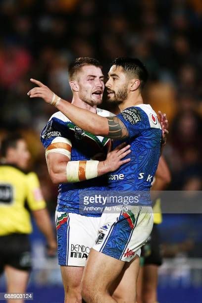 Shaun Johnson and Kieran Foran of the Warriors celebrate during the round 12 NRL match between the New Zealand Warriors and the Brisbane Broncos at...