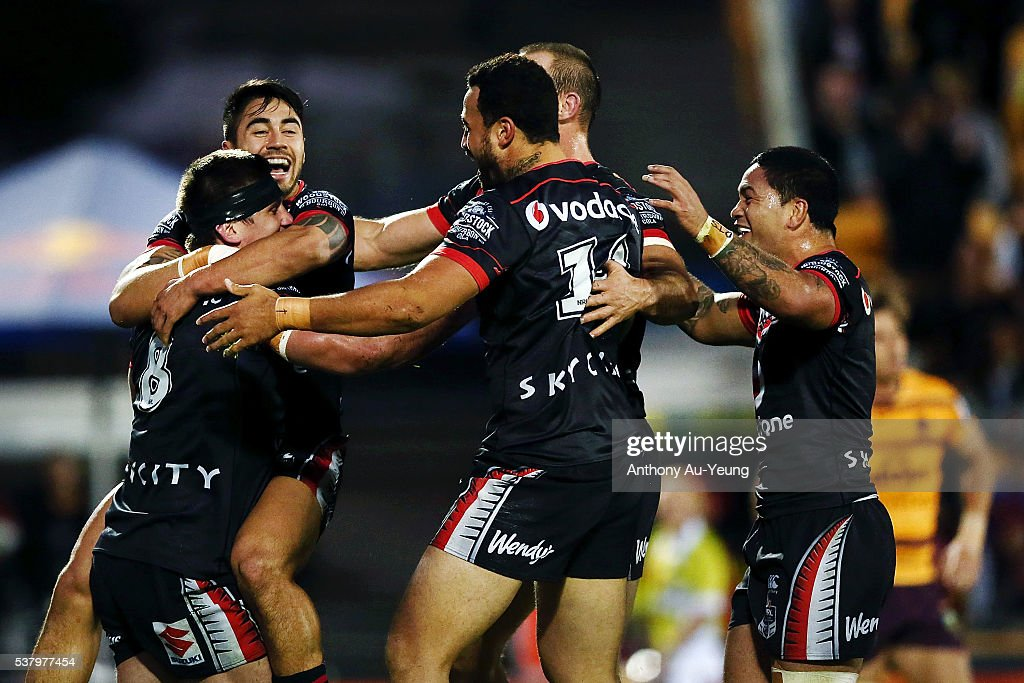 Shaun Johnson and the Warriors teammates rush in to celebrate Jacob Lillyman's try during the round 13 NRL match between the New Zealand Warriors and the Brisbane Broncos at Mt Smart Stadium on June 4, 2016 in Auckland, New Zealand.
