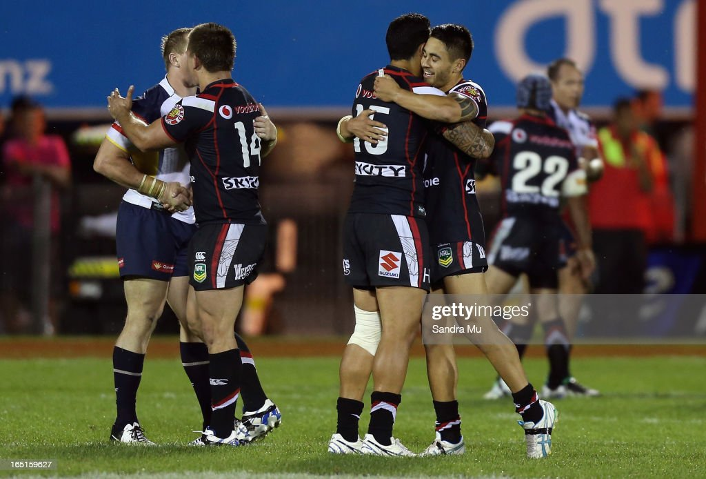 Shaun Johnson (R) hugs Feleti Mateo of the Warriors after winning the round four NRL match between the New Zealand Warriors and the North Queensland Cowboys at Mt Smart Stadium on April 1, 2013 in Auckland, New Zealand.