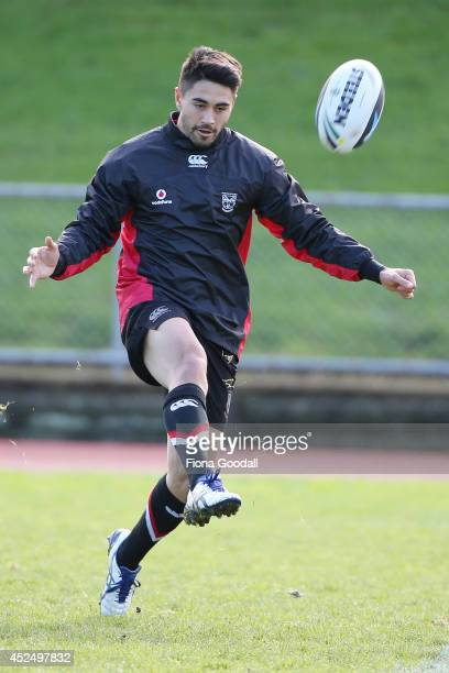 Shaun Johnson kicks the ball during a New Zealand Warriors NRL training session at Mt Smart Stadium on July 22 2014 in Auckland New Zealand