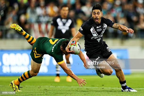 Shaun Johnson of New Zealand beats the defence of Cooper Cronk of Australia during the Four Nations Final between the New Zealand Kiwis and the...