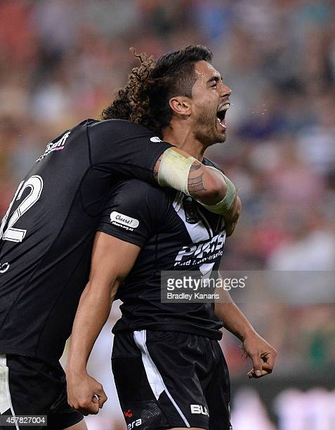 Shaun Johnson of New Zealand celebrates scoring a try during the Four Nations Rugby League match between the Australian Kangaroos and New Zealand...