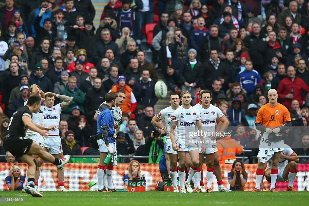 Shaun Johnson of New Zealand converts the winning try with the last kick of the game as the players of England look on during the Rugby League World...