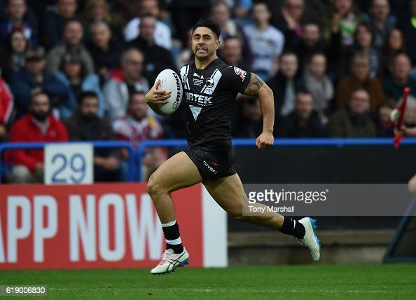 Shaun Johnson of New Zealand Kiwis runs in to score a try during the Four Nations match between the England and New Zealand Kiwis at the John Smith's...