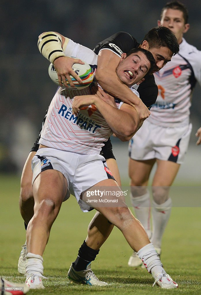 Shaun Johnson of New Zealand stackles Remi Casty pof France during the Rugby League World Cup group B match between New Zealand and France at Parc des Sports on November 1, 2013 in Avignon, France.