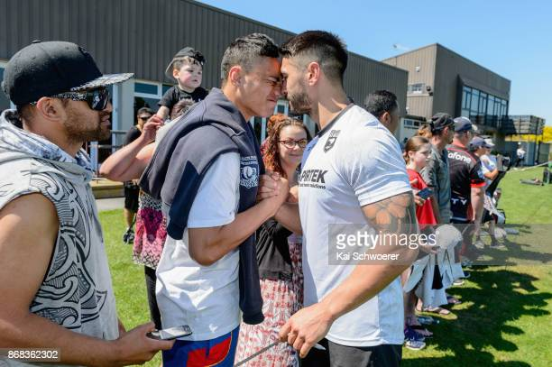 Shaun Johnson of the Kiwis receives a hongi a traditional Maori welcome from a fan following a New Zealand Kiwis Rugby League World Cup training...