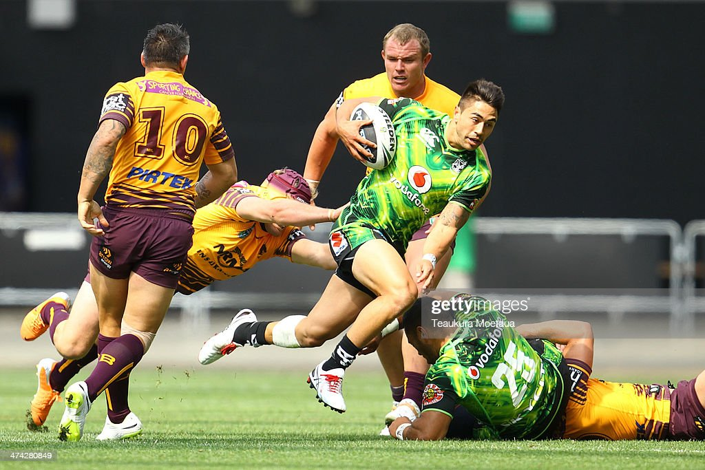 Shaun Johnson of the New Zealand Warriors makes a break during the NRL trial match between the Brisbane Broncos and the New Zealand Warriors at Forsyth Barr Stadium on February 23, 2014 in Dunedin, New Zealand.