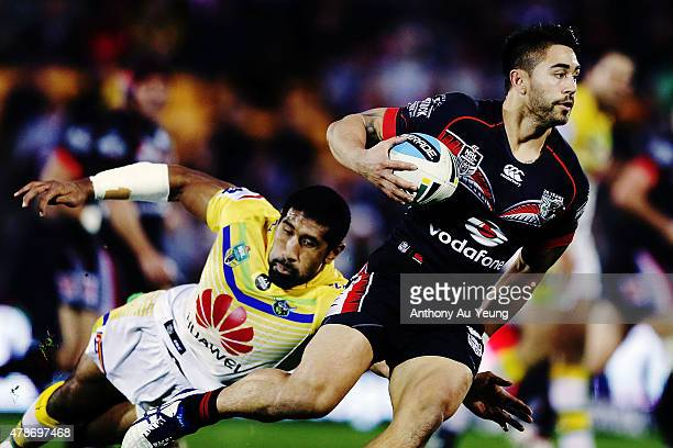 Shaun Johnson of the Warriors beats the tackle from Iosia Soliola of the Raiders during the round 16 NRL match between the New Zealand Warriors and...