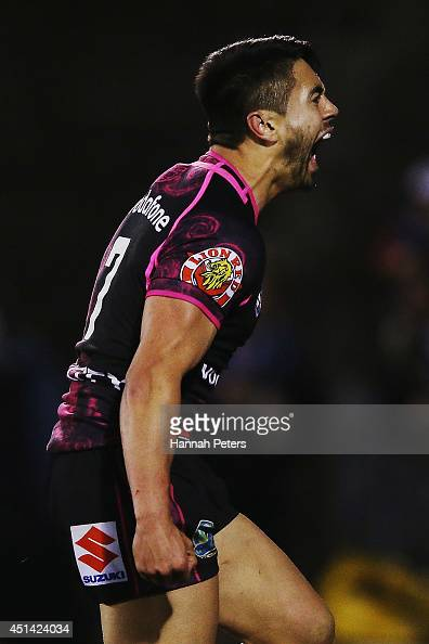 Shaun Johnson of the Warriors celebrates after scoring a try during the round 16 NRL match between the New Zealand Warriors and the Penrith Panthers...