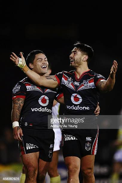 Shaun Johnson of the Warriors celebrates after scoring a try with teammate Issac Luke during the round 17 NRL match between the New Zealand Warriors...