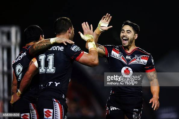 Shaun Johnson of the Warriors celebrates Bodene Thompson's try during the round 17 NRL match between the New Zealand Warriors and the Gold Coast...