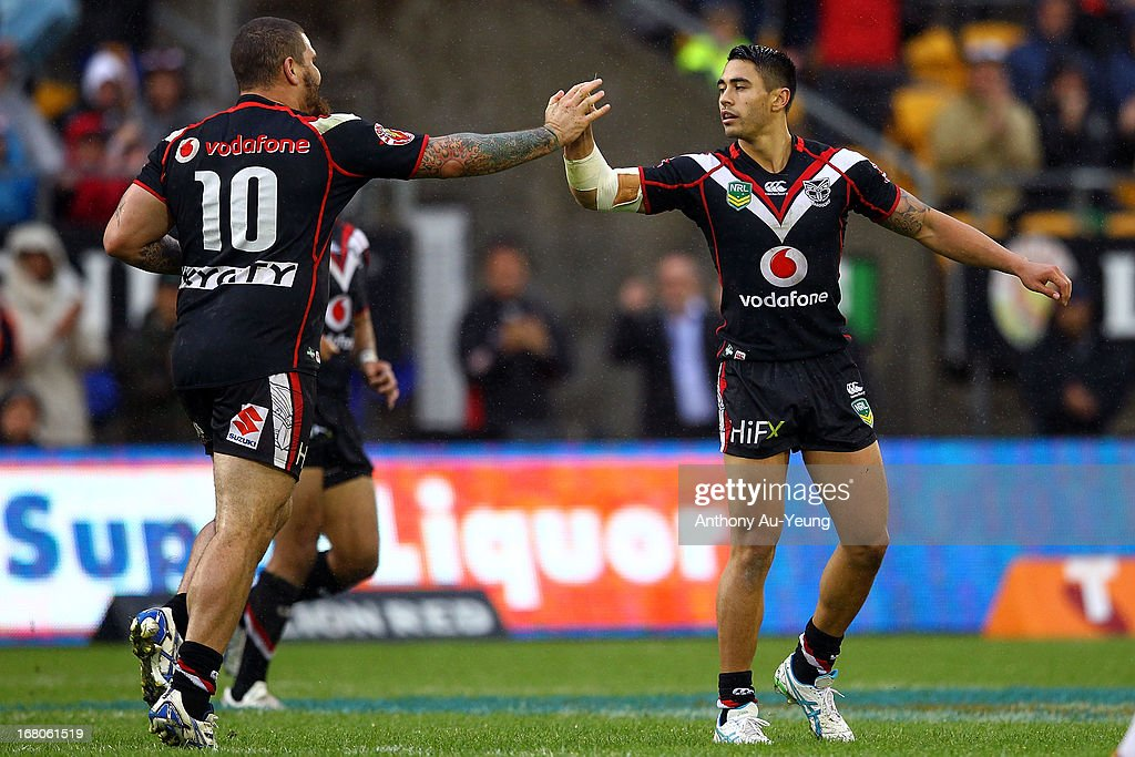 Shaun Johnson of the Warriors celebrates his drop goal with Russell Packer during the round eight NRL match between the New Zealand Warriors and the Gold Coast Titans at Mt Smart Stadium on May 5, 2013 in Auckland, New Zealand.